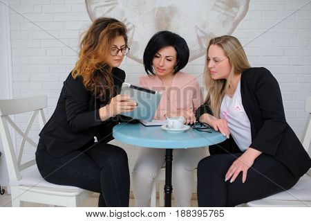 Three Business Women Have A Meeting