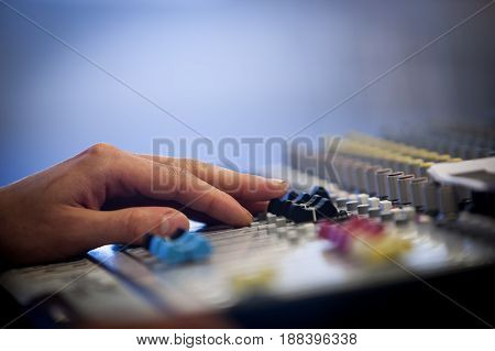 Professional audio mixing console with faders and adjusting knobs radio TV broadcasting