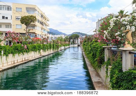 Reflection on canal inside marmaris city with mountains background marmaris Turkey