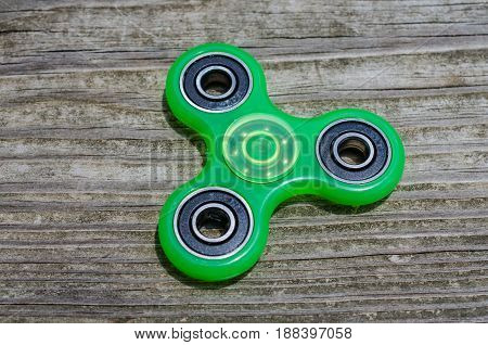 Fidget spinner in motion, game toy.  Popular spinning gadget enjoyed by children and adults.