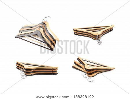 Pile of wooden hangers isolated over the white background, set of four different foreshortenings