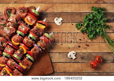 Fresh raw meat and vegetable barbecue on skewers. Top view. Flat lay.