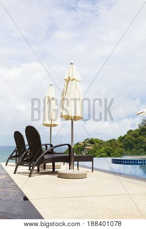 Beach chair in outdoor with swimming pool and sea view andaman sea