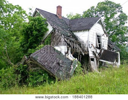 an old, abandoned home is falling in around itself