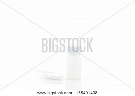 White plastic medical container with realistic medical measuring spoon isolated on white background