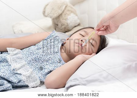 Mother Measuring Temperature Of Her Ill Kid