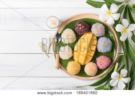 Ripe Mango With Sticky Rice On Wood Background