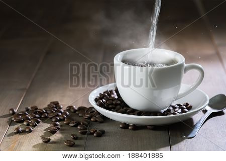 Put Hot Water To Cup Coffee With Smoke