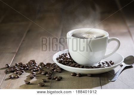 Hot Coffee With Smoke On Brown Wood