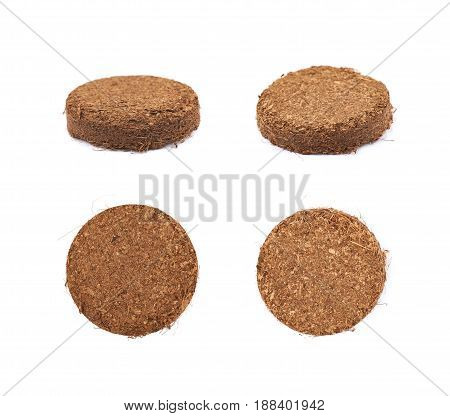 Compressed compost tablet isolated over the white background, set of four different foreshortenings