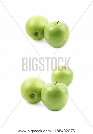 Pile of green apples isolated over the white background, set of two different foreshortenings