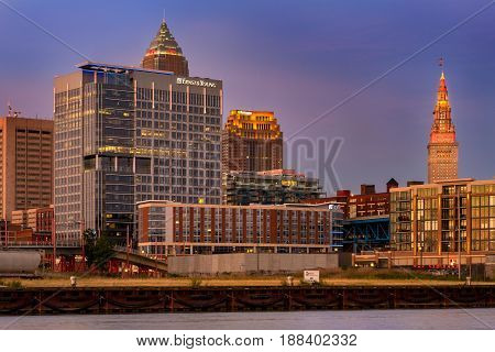 CLEVELAND OH - JUNE 19 2016: The Ernst & Young Building and the Aloft Hotel are two of the newer buildings in the Flats overlooking the Cuyahoga River near its lakefront outlet.