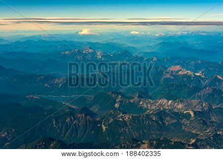 Aerial view of Washington's Cascade Mountains with Spada Lake in foreground left and Mt. Baker and Mt Shuksan on the horizon