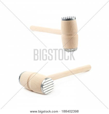 Meat tenderizer wooden hammer isolated over the white background, set of two different foreshortenings