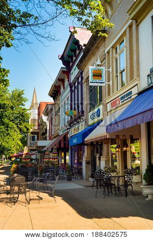 GRANVILLE OH - MAY 15 2017: Shops businesses and dining establishments with sidewalk seating line the downtown block of this charming village about 30 miles east of Columbus.
