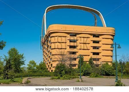 NEWARK OH - MAY 15 2017: The world's largest picnic basket was once the headquarters of the Longaberger Company. It stands 7 stories tall and is twice as long as a football field at the top. It has been empty since 2016.