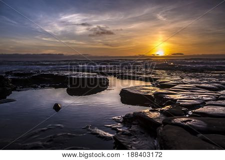 Tidepools in southern California La Jolla at sunset with hazy skies