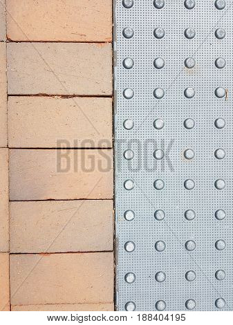 grey cement with bumps and red bricks
