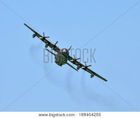 Military cargo plane in flight front view