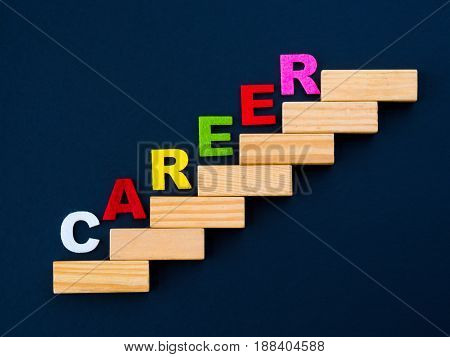 "Wood block stacking as step stair with colorful of ""CAREER"" word on it in black background. Business concept for success process."