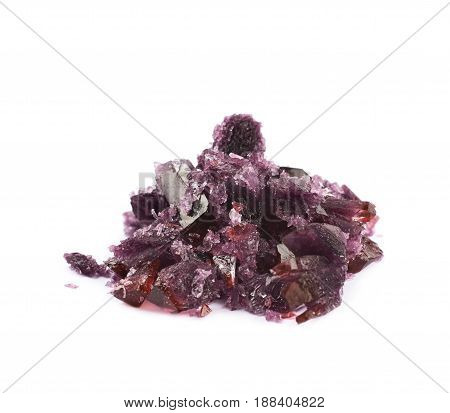 Grown crystal of maroon colored salt isolated over the white background