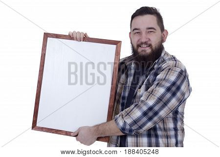 Smiling bearded young man with white board in hands