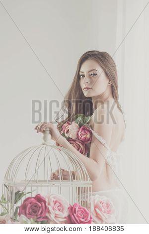 Lovely girl in underwear. Bra of flowers. Spring mood. She looks at the frame. Soft focus.