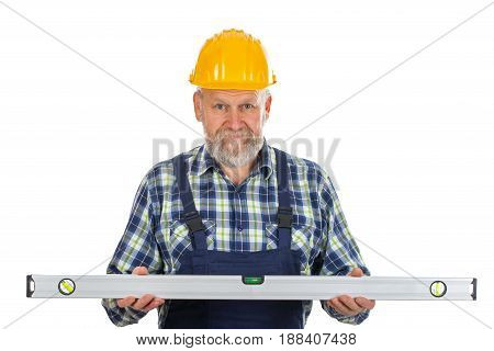 Picture of an elderly builder holding a spirit level tool posing on isolated background