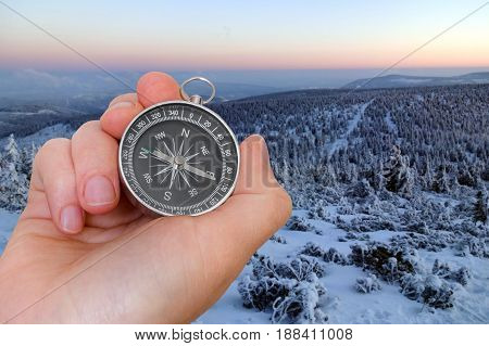 Woman With Compass Is Seeking A Right Way In Mountains