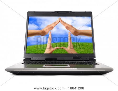Conceptual Home symbol on a laptop computer display Real Estate Environmental technology concept