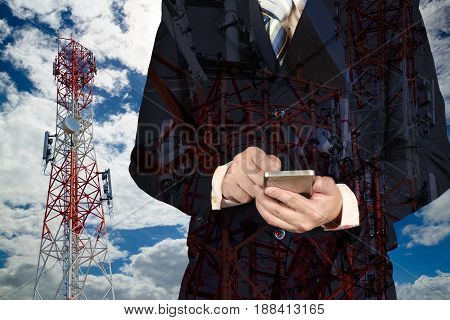 Businessman Working Smartphone, With Double Exposure Blue Sky Telecommunication Towers.