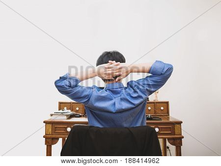 a guy relaxing at work place, on white background
