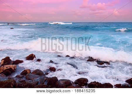 Beautiful Pink Tinted Waves Breaking On A Rocky Beach At Sunrise On East Coast Of Big Island Of Hawa