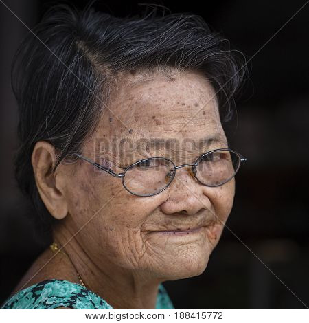 KOH PHANGAN THAILAND - NOVEMBER 19 2016 : Portrait old woman in street market close up