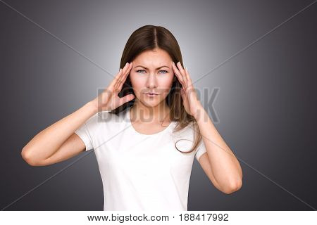 Stress and headache. Young woman having pain. holds his head in his hands.