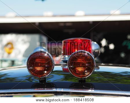 Detail of a vintage police car in front of a big warehouse