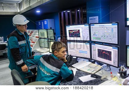 Tobolsk Russia - July 15. 2016: Sibur company. Central control panel of Tobolsk Polymer plant. Engineering personnel work with equipment