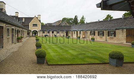 MALMESBURY UK - MAY 1 2017: The Courtyard Entrance at Whatley Manor in The Cotswolds near Malmesbury Wiltshire England UK