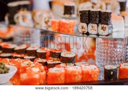 large holiday set of fresh tasty fish Japanese rools and sushi