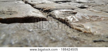 Road pavement made of stones close view background