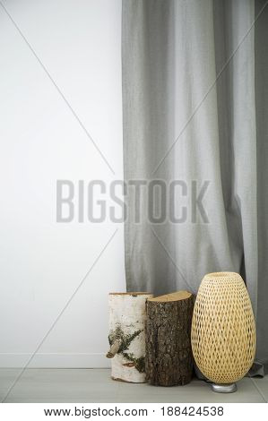 White home interior with wood decoration rattan lamp grey curtain