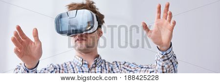 Young handsome man testing new VR technologies