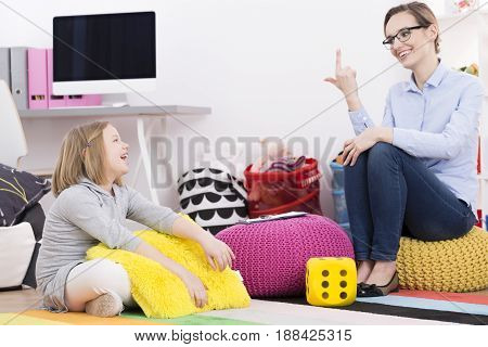 Psychotherapist Teaching Girl To Count