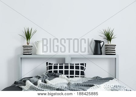 Bed, Blanket, Cushion, And Plants