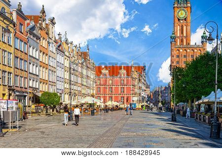 GDANSK POLAND - MAY 19 2017: Peoples on Long Street one of Europe's most beautiful town with renaissance building of the former Town Hall in Gdansk. Old Town in Gdansk is a tourist attraction for visitors.