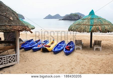 View of nice empty sand beach in bay near mountain