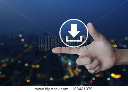 Download icon on finger over blur colorful night light city tower Business internet concept