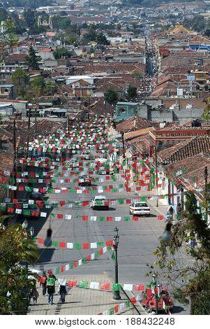 Cristobal de las Casas, Mexico - 19 January 2009: Aerial view to San Cristobal de las Casas with numerous religious flags