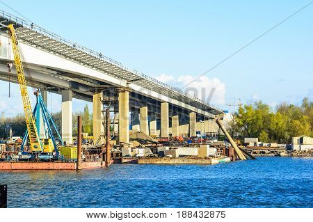 Construction of a modern bridge across the river