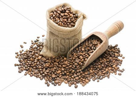 canvas bag full of coffee beans with wooden scoop on white background